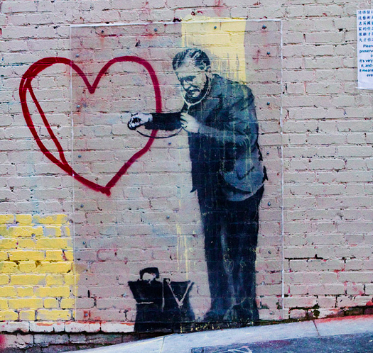 "Image via Flikr Creative Commons. Bansky's ""Peaceful hearts Doctor"" courtesy of Eva Blue."